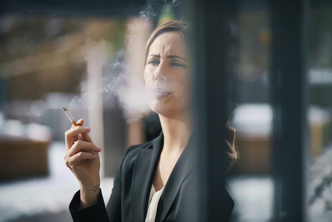 business woman smoking cigarette