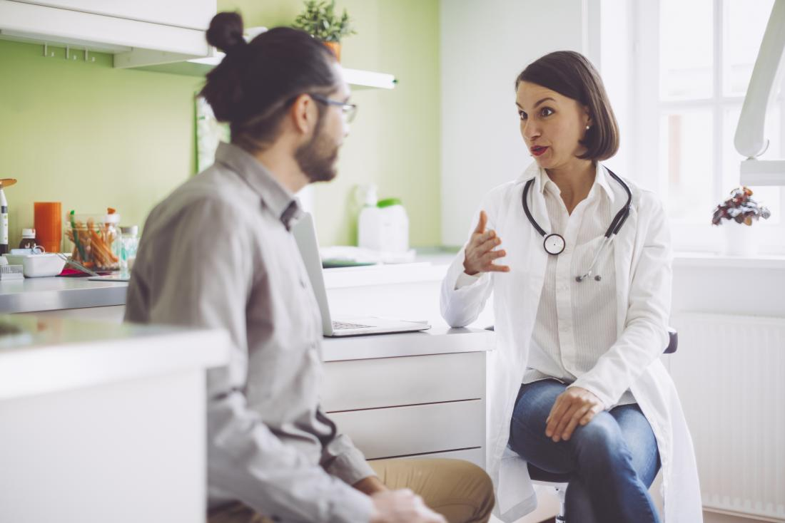 Doctor consulting with patient and discussing hiv and cancer