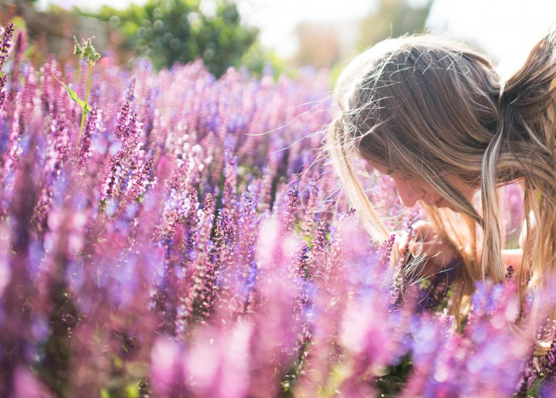 person smelling lavender