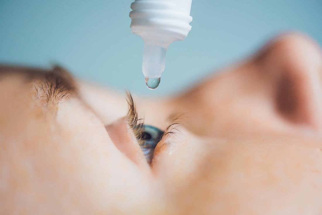 eye drop being added to eye