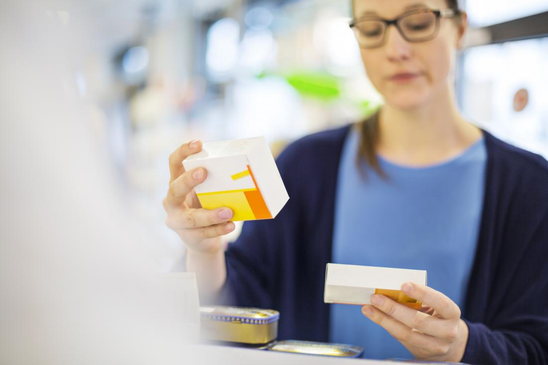 Pharmacist with medication in boxes