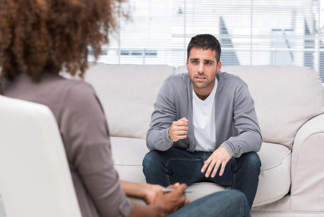 man discussing issues with a therapist