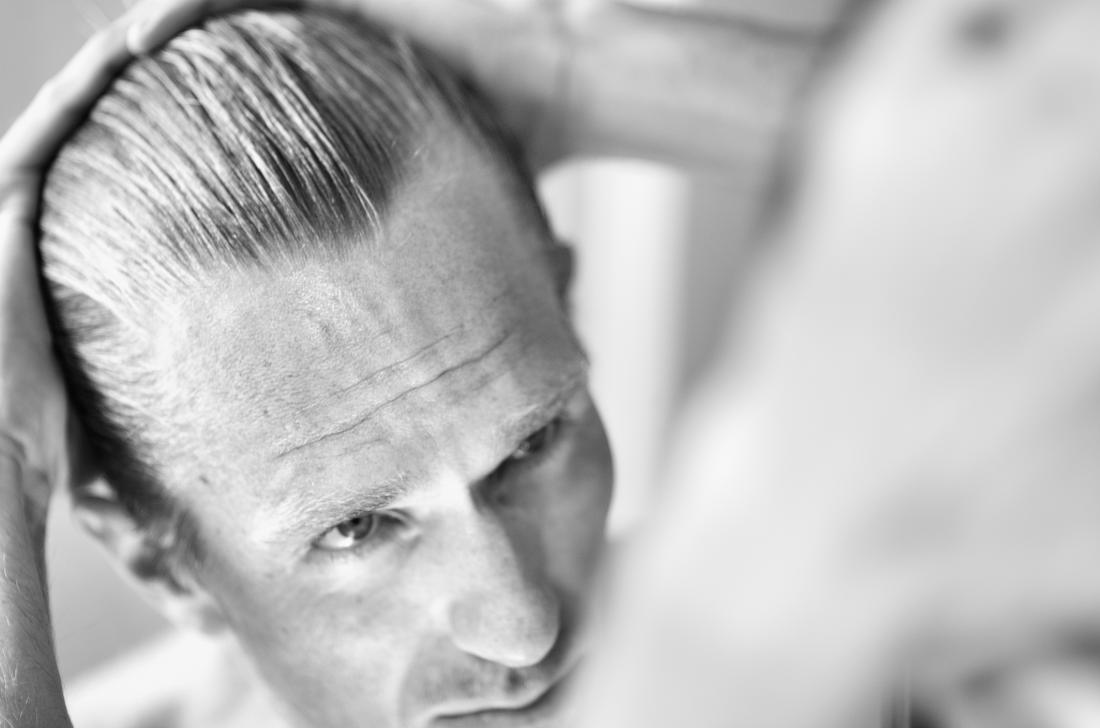 Man reflection hair loss