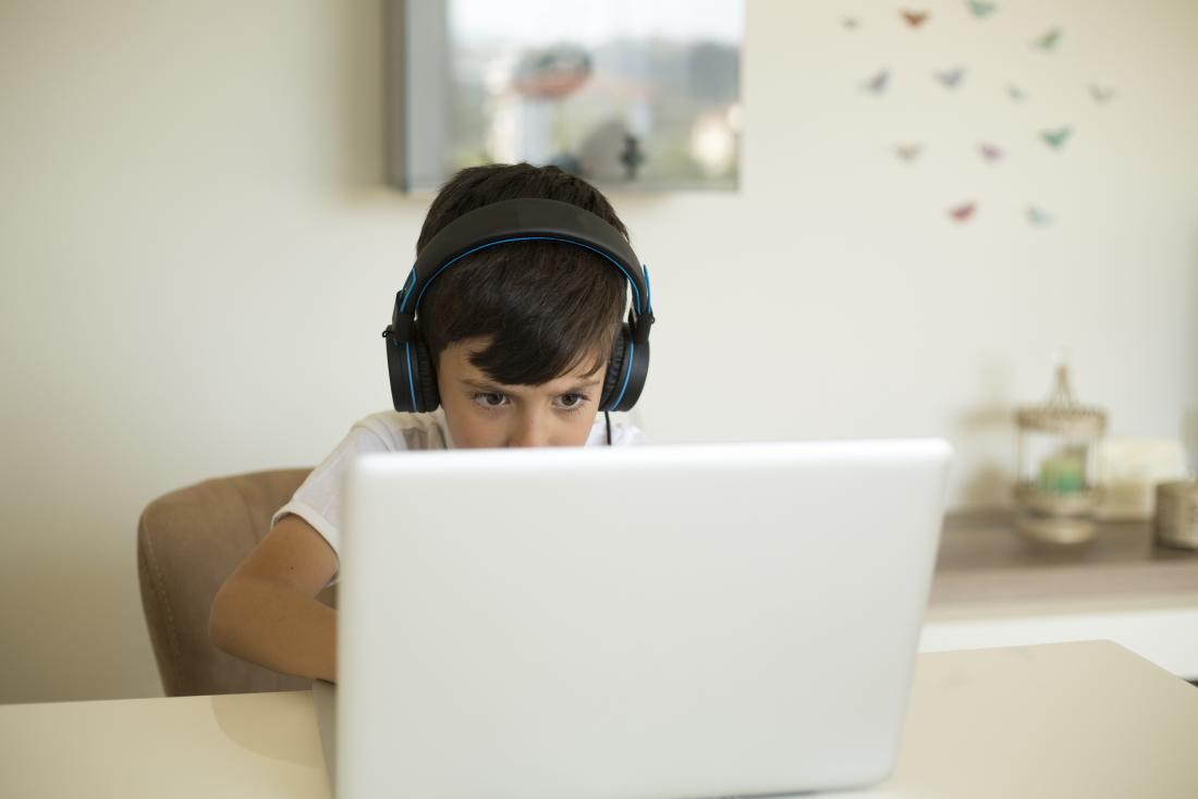 young boy playing computer games