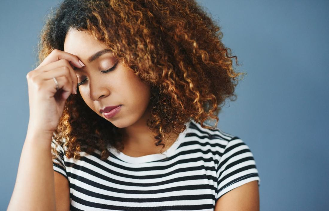 Woman with stress holding her forehead