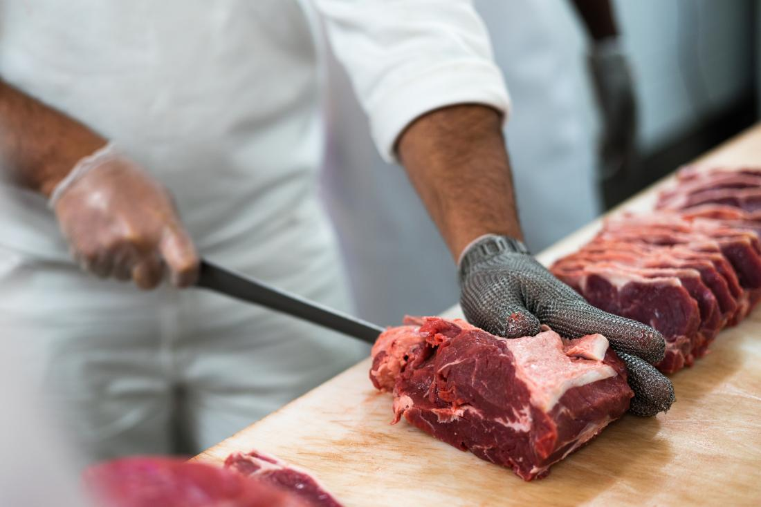 Raw meat being cut