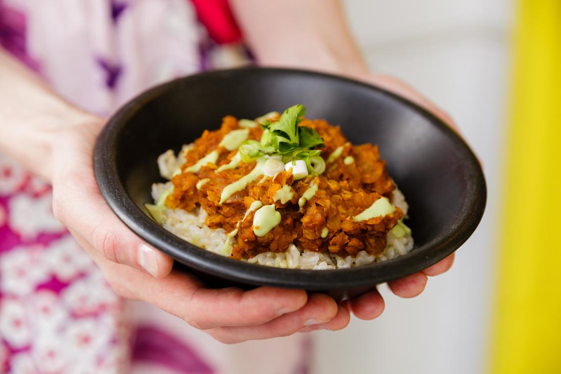 Mexican lentil with rice and avocado aioli in bowl