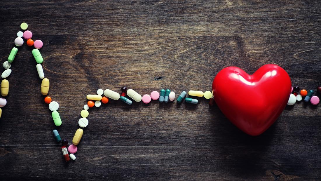 concept photo of heart pills and pulse