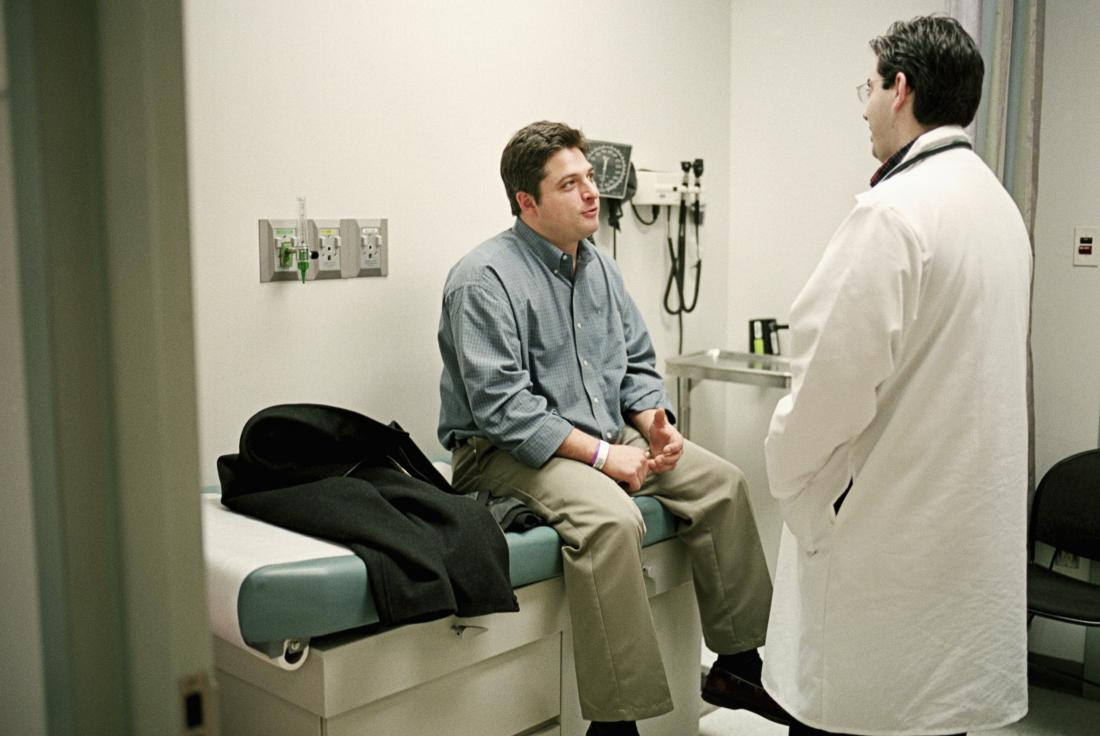 Man sitting on examination bed in doctor's office
