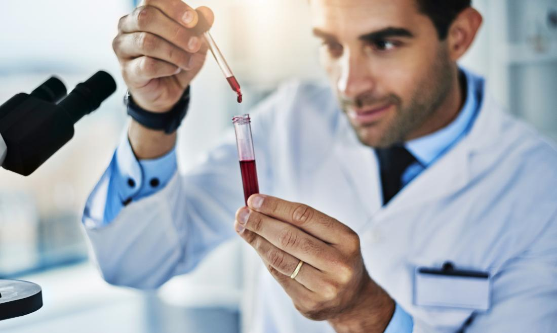 Lab technician working with a blood sample for a cholesterol test