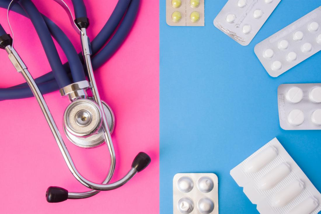 pills and stethoscope against a pink and blue background