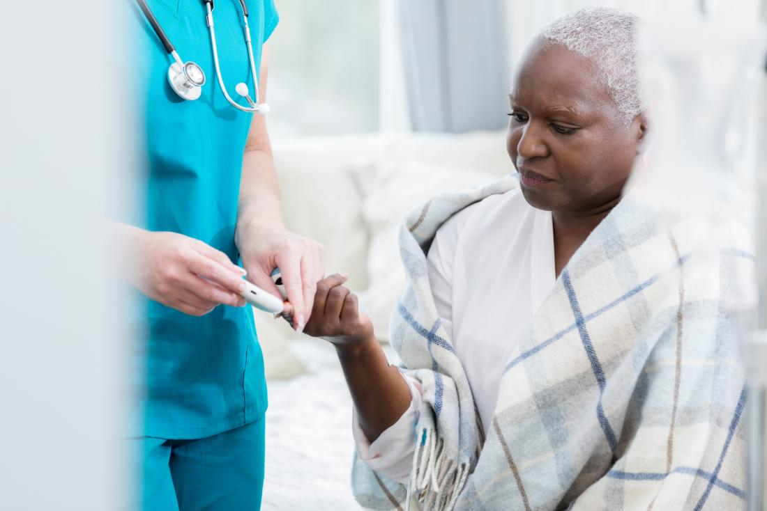 senior woman having an insulin shot from healthcare professional
