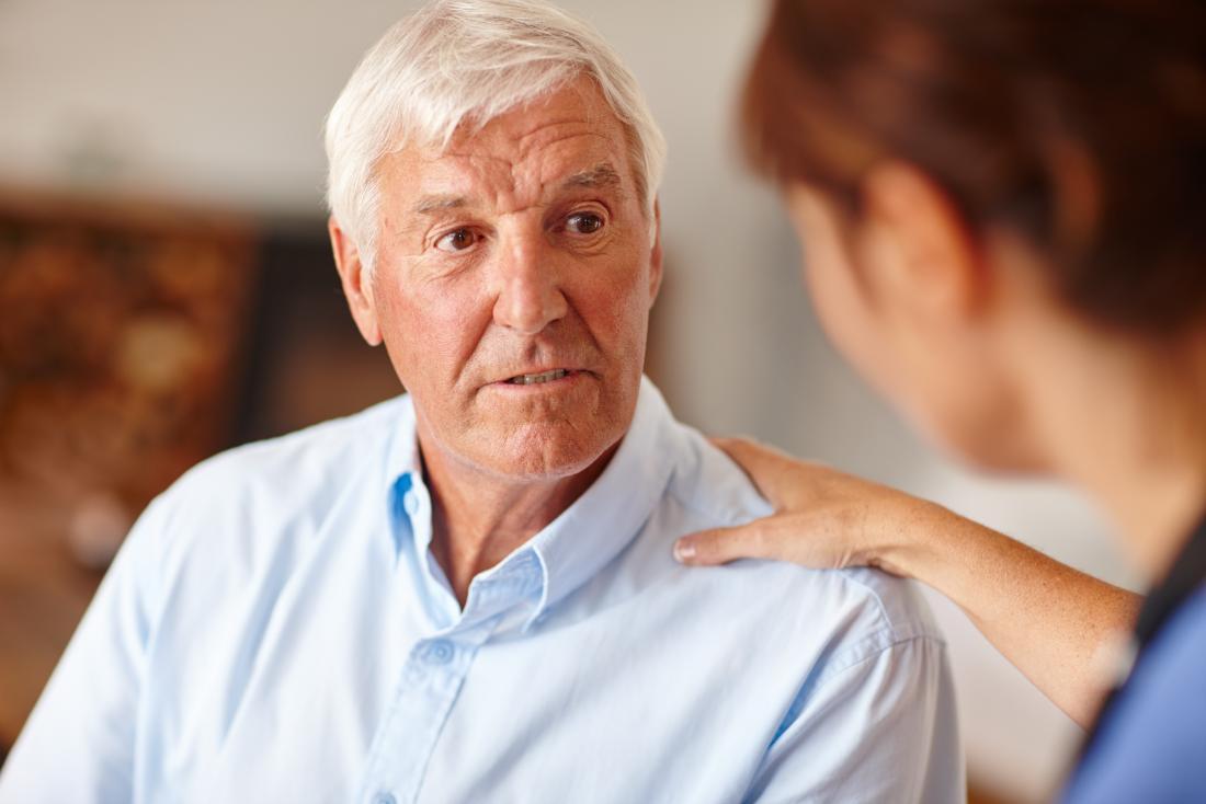 senior man speaking to doctor