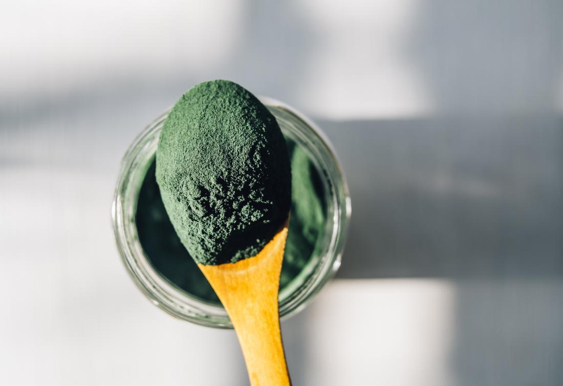 spirulina powder on a spoon