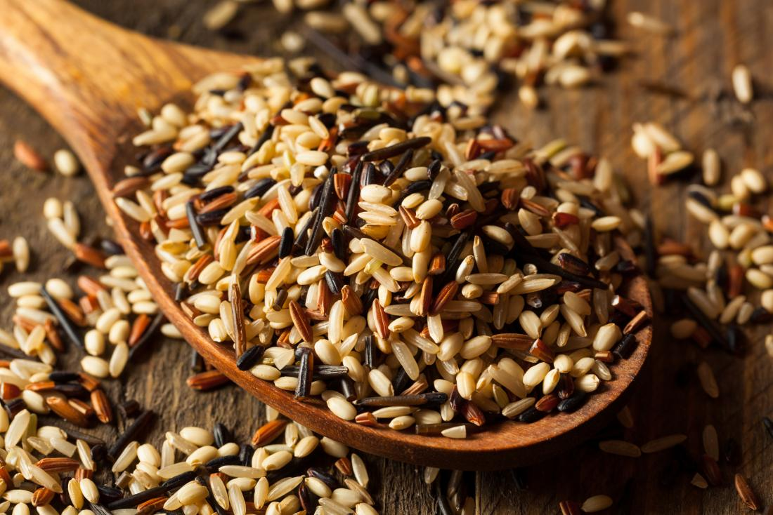 Wild rice on a spoon which is a food to avoid for crohn's disease