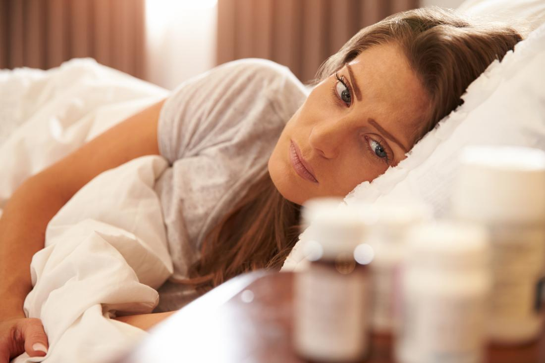 Woman awake in bed wondering which is the best sleeping pill to take
