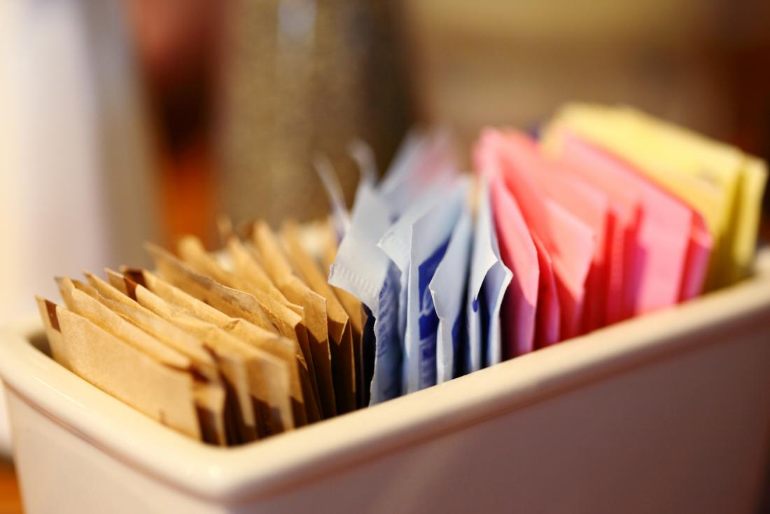 Sweeteners in individual packets in tray