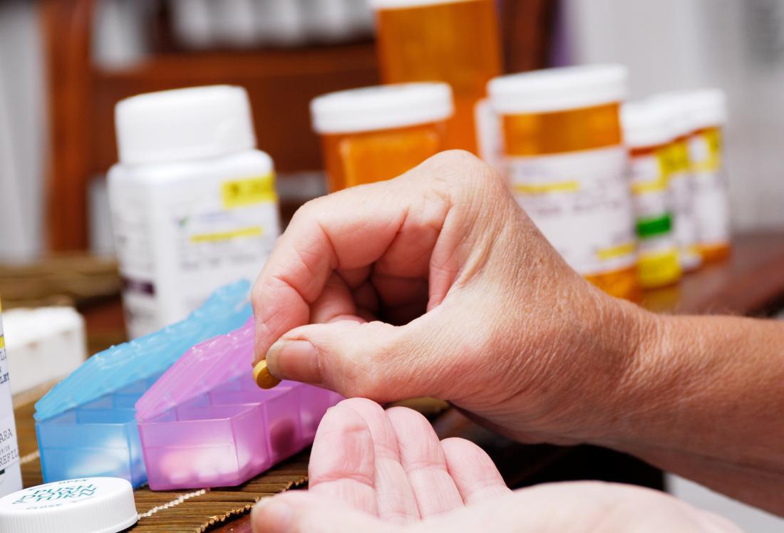 Woman organising prescription pills