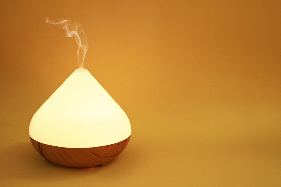 Oil diffuser on orange background.