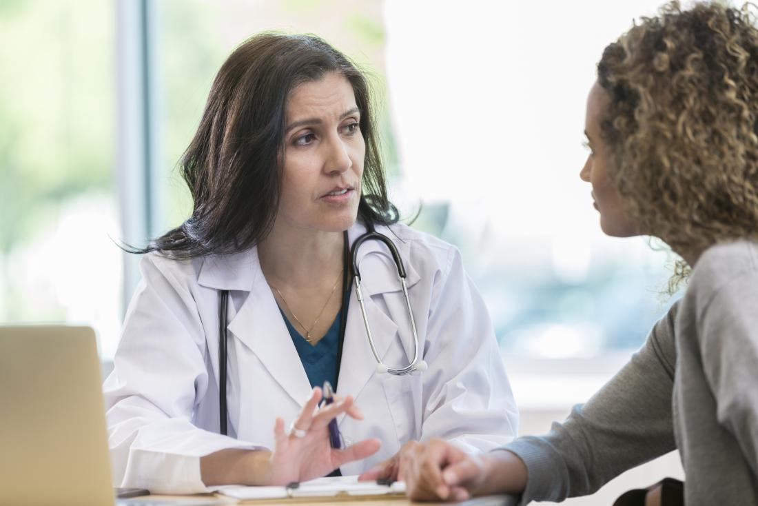 Doctor and patient both female talking over desk