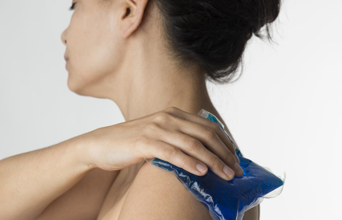 Ice pack being applied to the shoulder for a pinched nerve