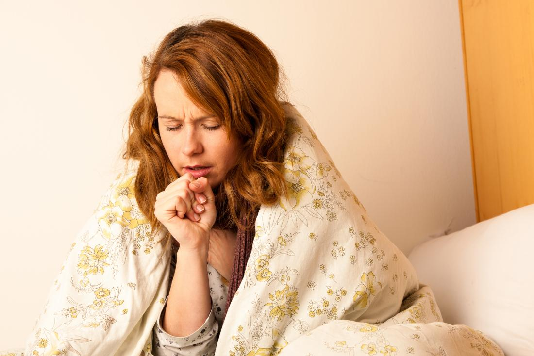 woman coughing due to the flu or bronchopneumonia