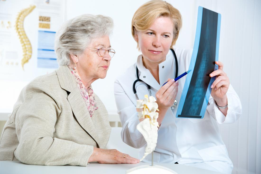 doctor and patient looking at xray of spine