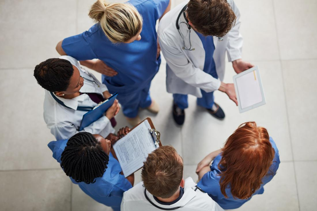 health professionals discussing patients diagnosis
