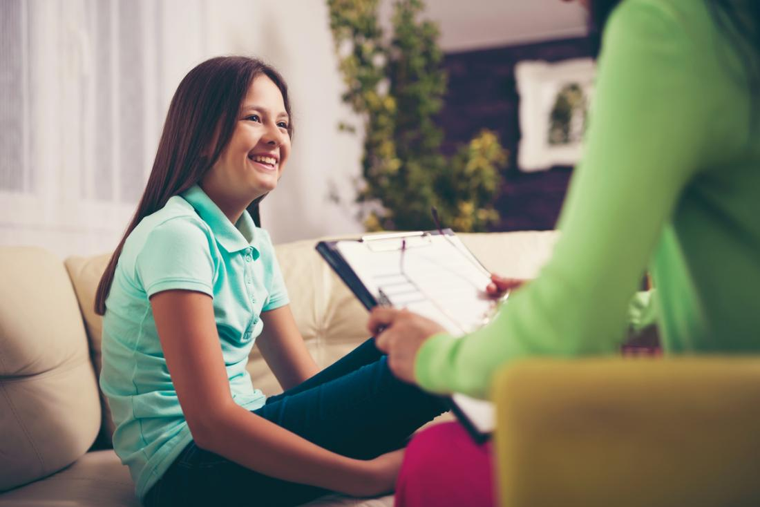 Teenage girl having therapy with female counsellor.