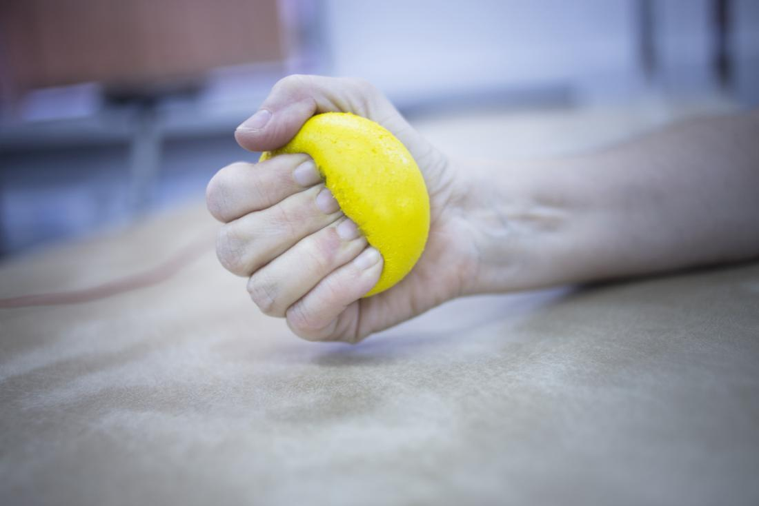 person squeezing stress ball.