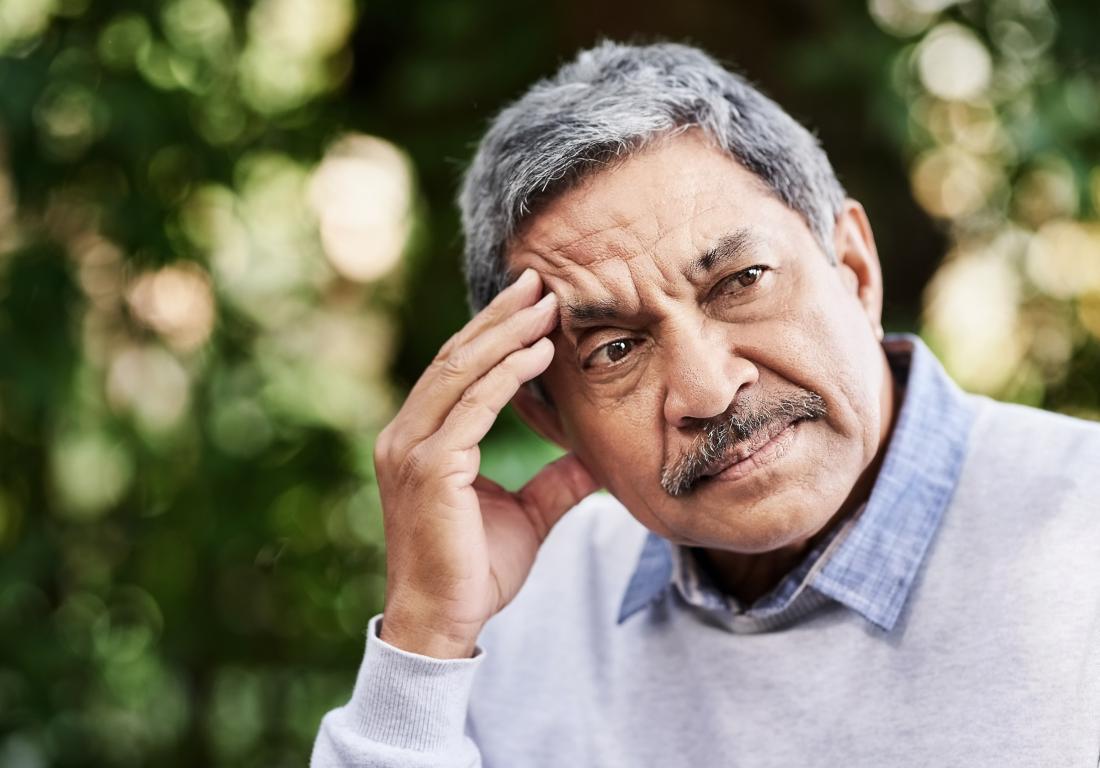 senior man sitting outside thinking