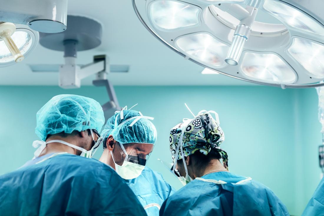 surgeons performing gastrectomy in operating theatre