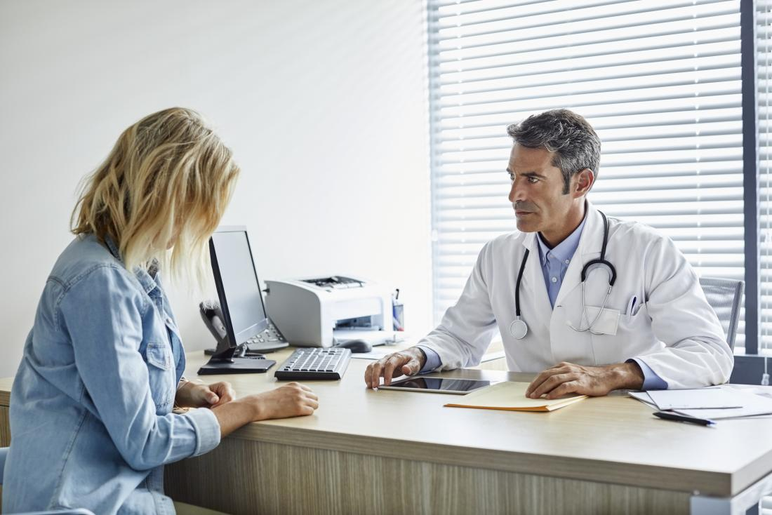 woman having consultation with doctor
