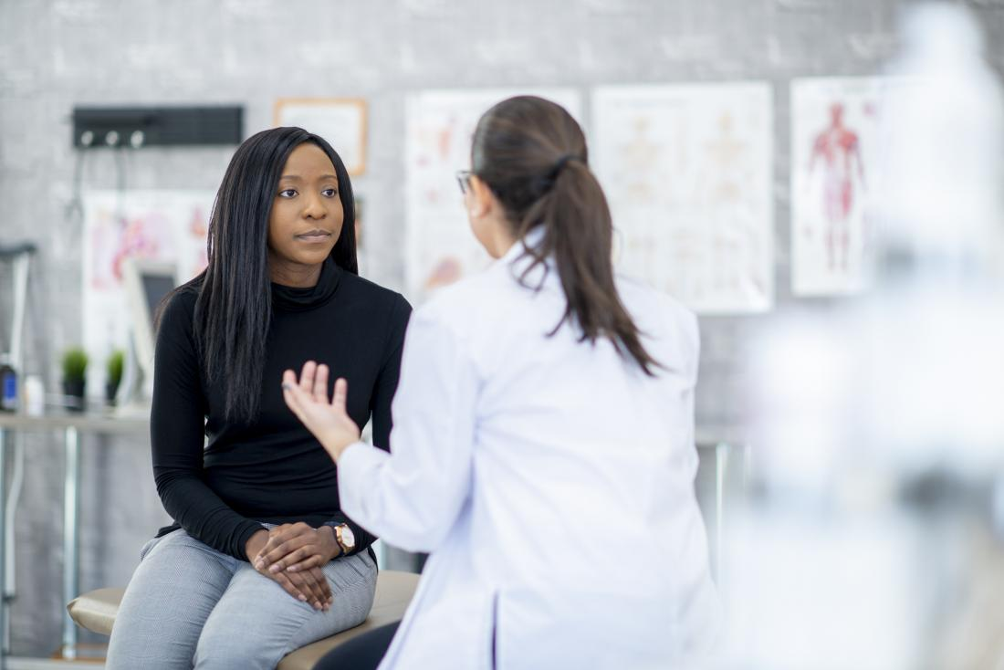 doctor offering advice to patient