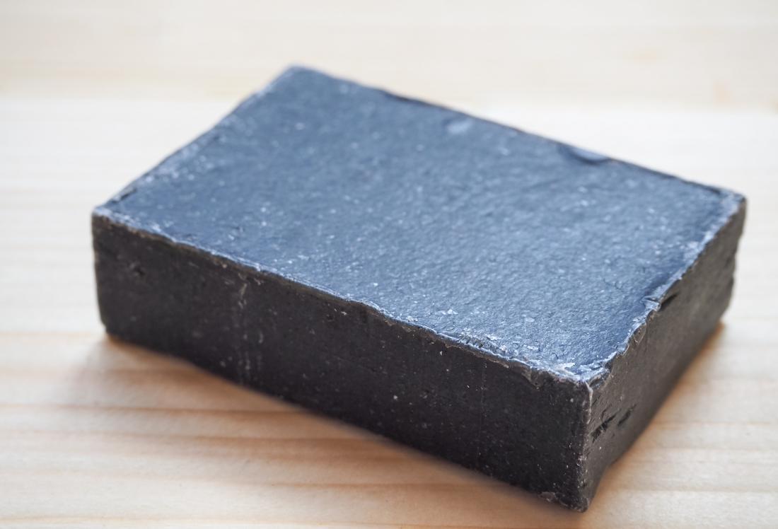 Dark coal tar soap.