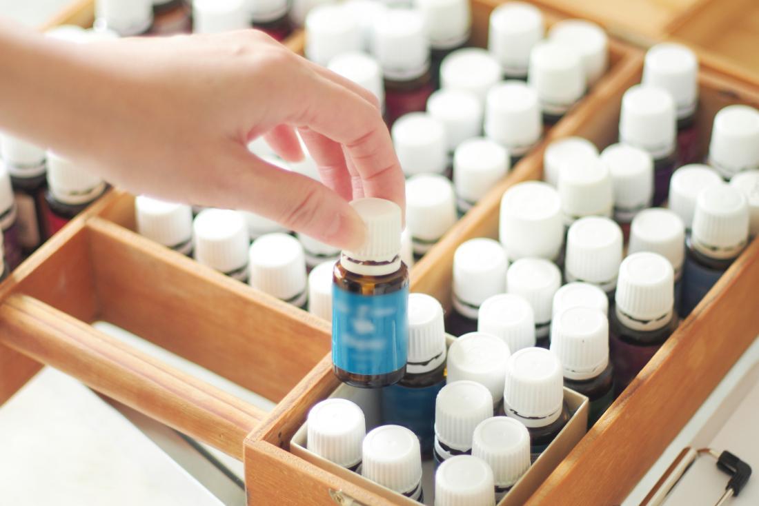 woman choosing essential oil