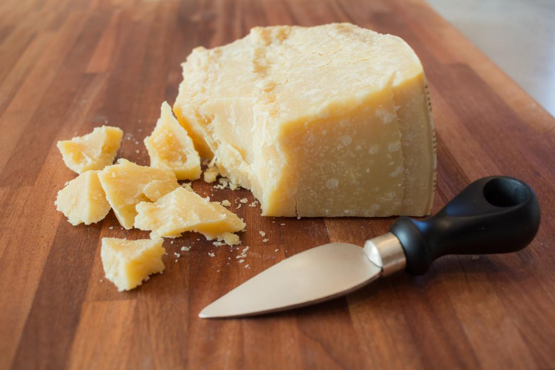 Cheese on wooden board.