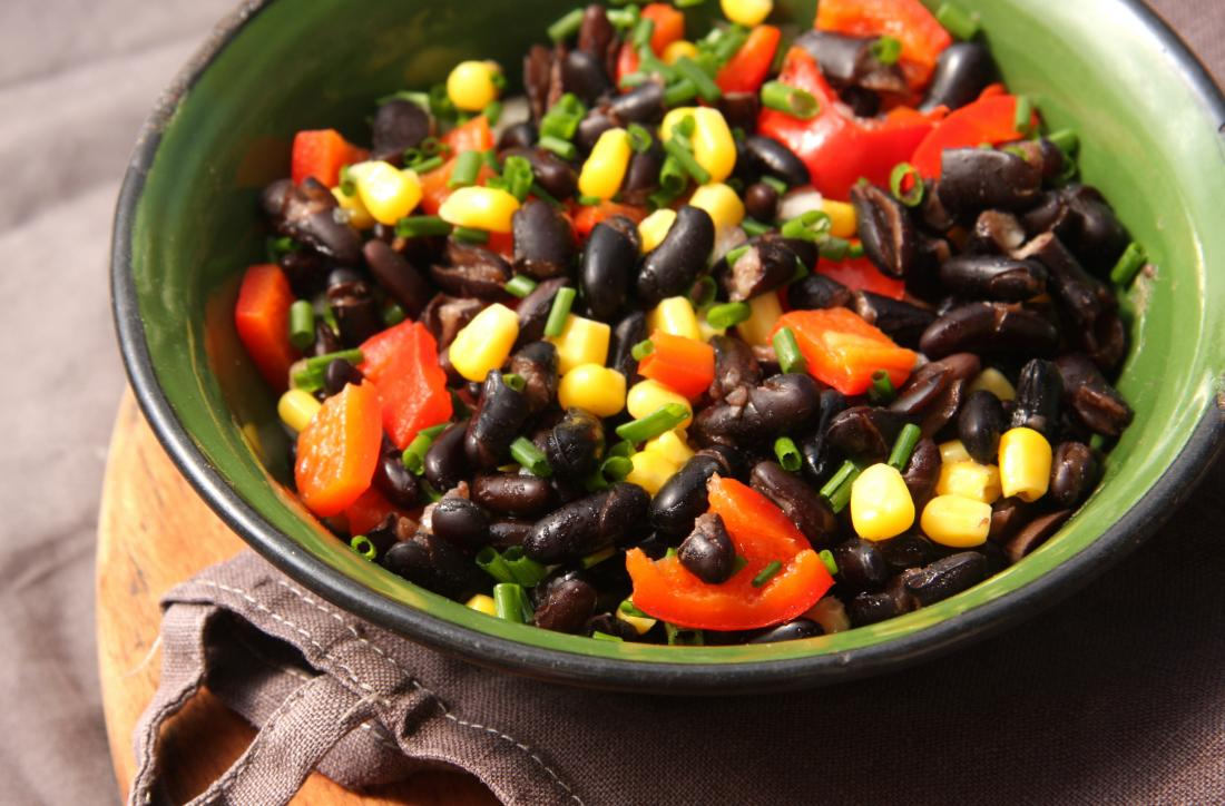 Black bean salad in bowl with red pepper and sweetcorn