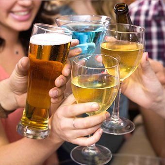 Friends toast each other with various alcohol drinks.