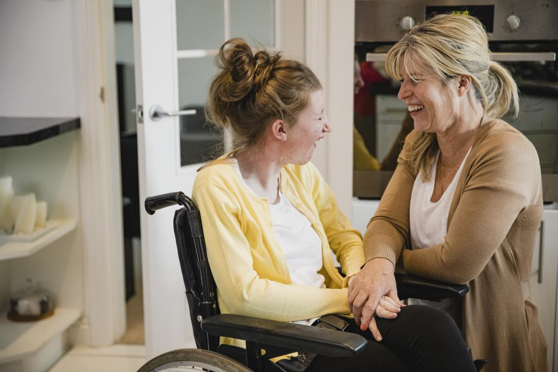mum and daughter in wheelchair laughing