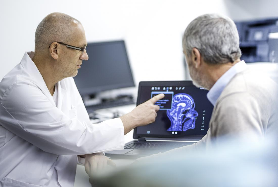 doctors looking at a brain scan