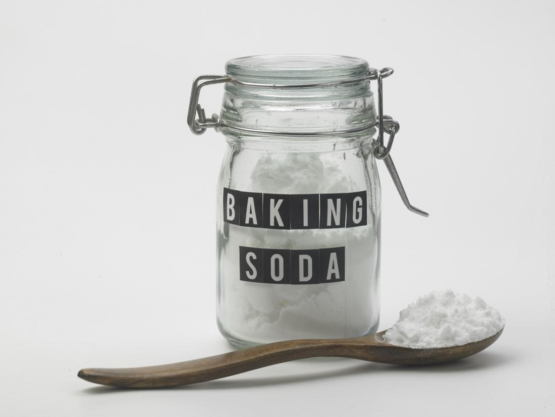 Baking soda jar and on spoon