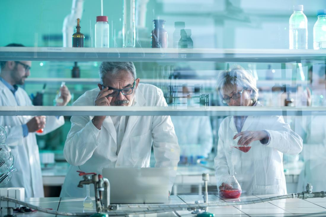 older scientists in research lab