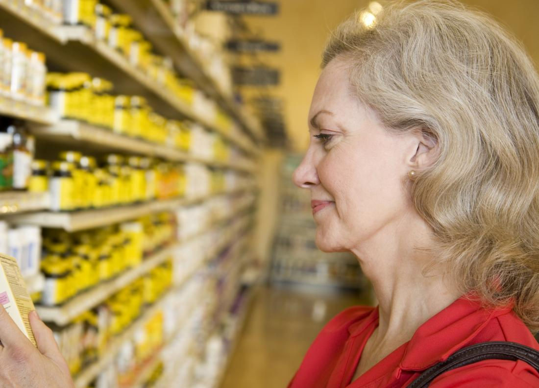 woman looking at supplements in a shop