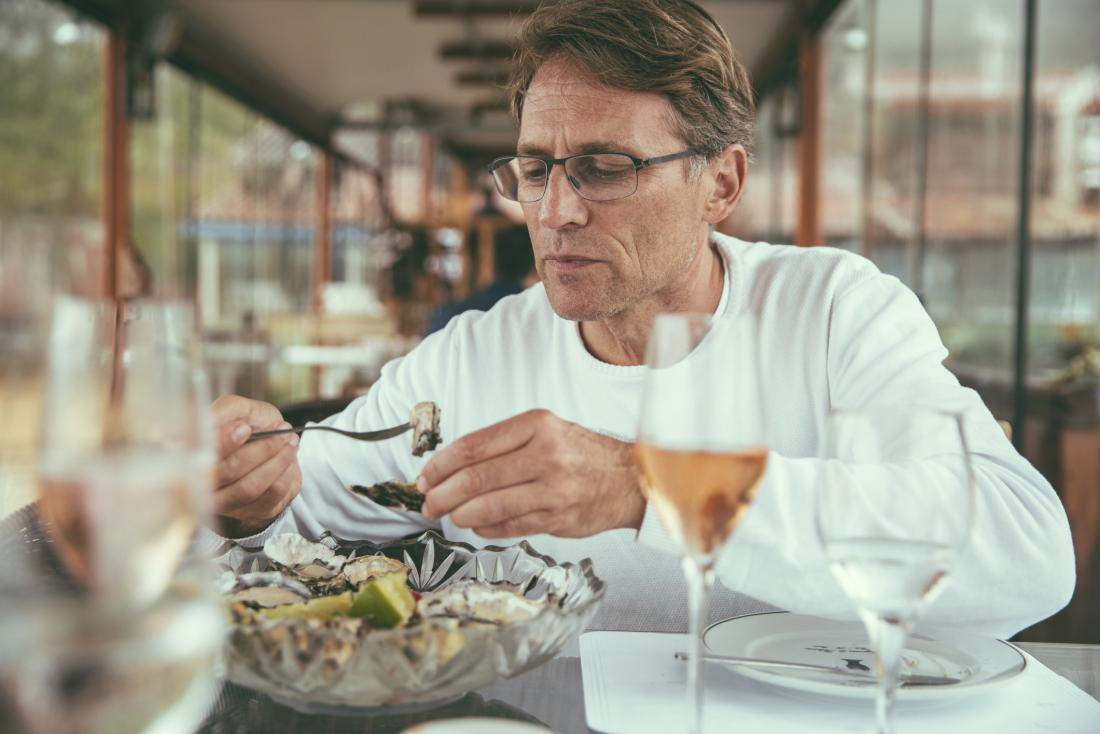 person eating shellfish