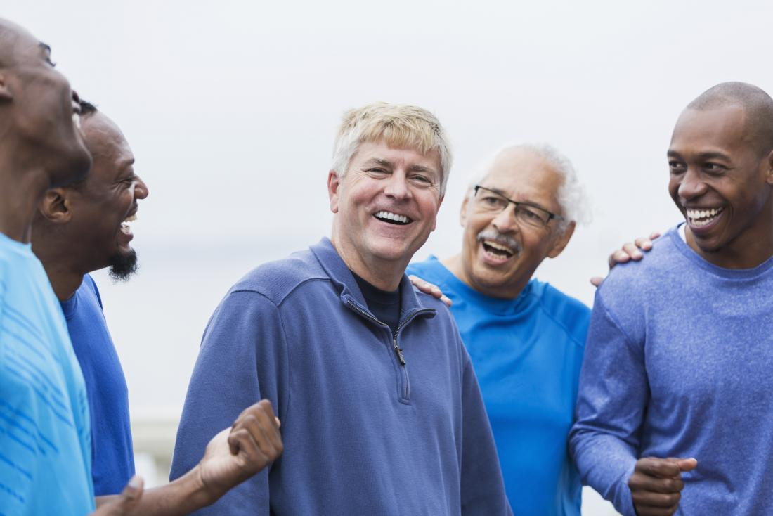 group of mixed age and ethnicity male friends