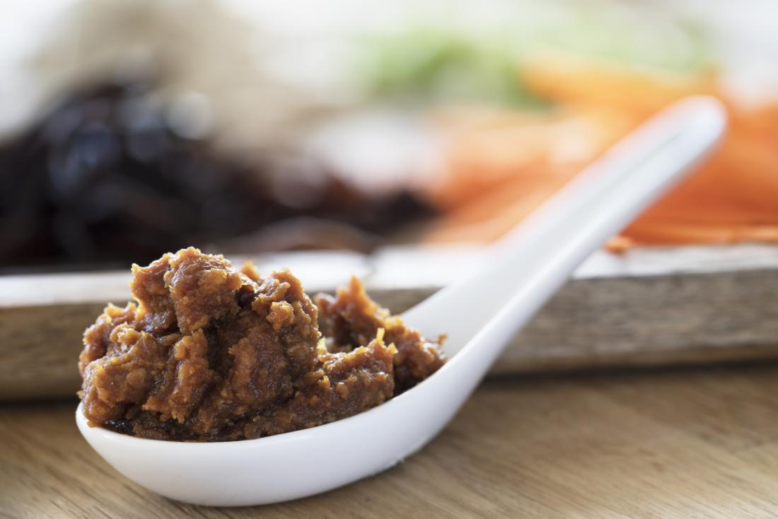 Red miso on a spoon that contains lactobacillus acidophilus
