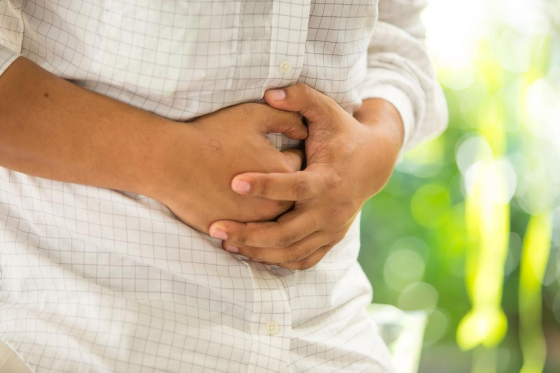 man holding stomach in pain