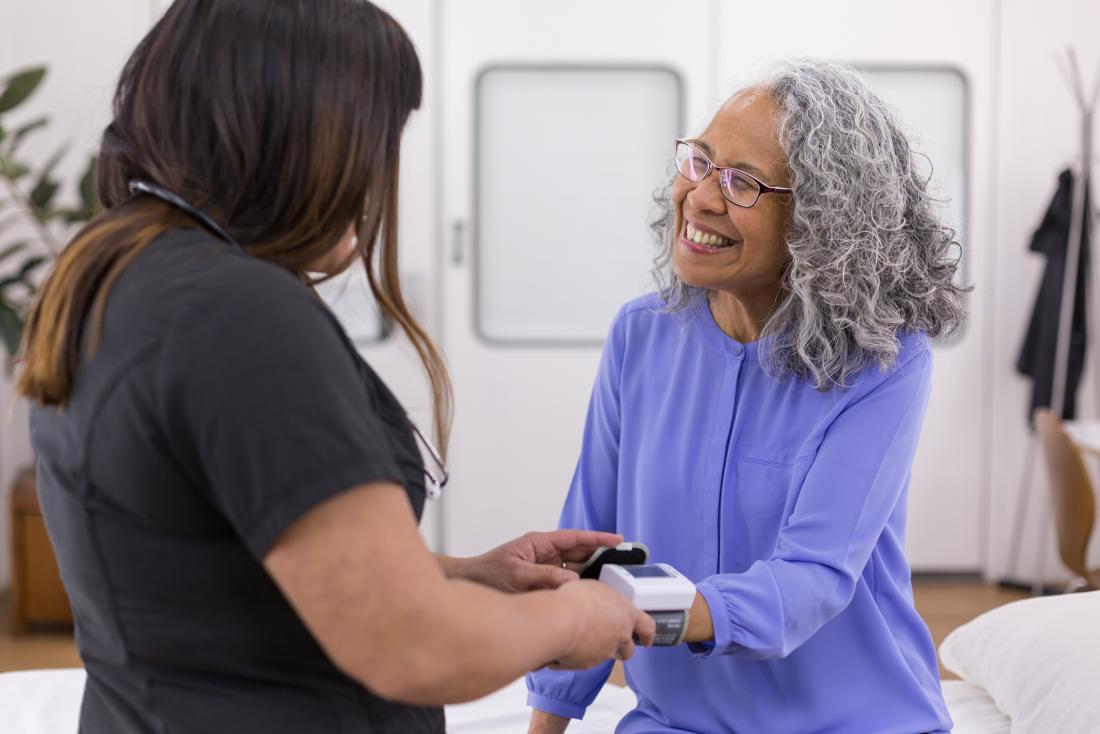 senior woman has her blood pressure taken