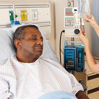 A nurse checking a patient's IV bag.